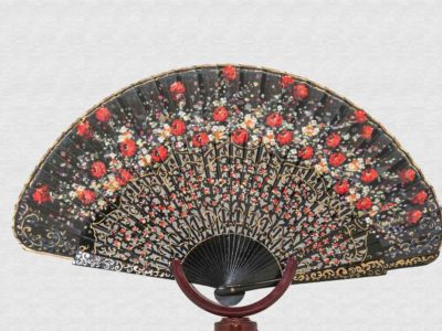 Black lacquered wood fan and polished back.