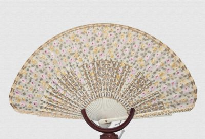 Ivory lacquered wood fan and polished back.