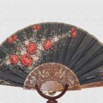 Lacquered sipo wood fan and black cotton cloth